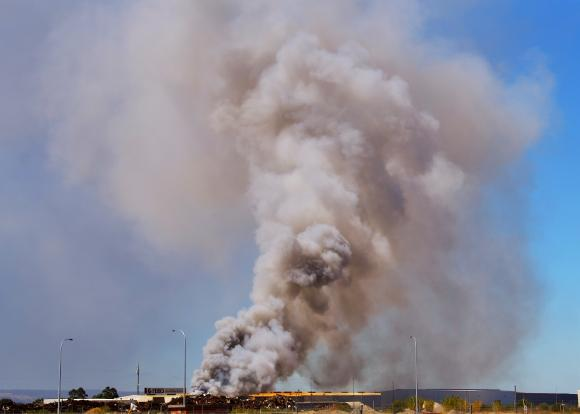 Scrapyard fire with billowing smoke